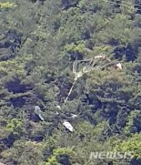 여수 야산에 경비행기 추락…조종사 탈출