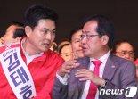 출마지 변경 홍준표, 완강한 김태호..험지출마에 엇갈린 한국당 중진