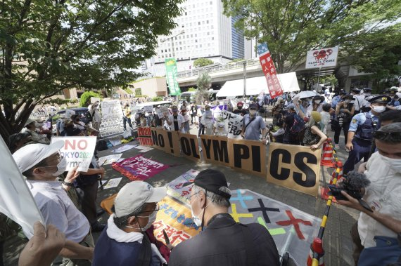 '우여곡절' 끝에 열린 올림픽...개막일 일본 사회의 표정은 [도쿄리포트]